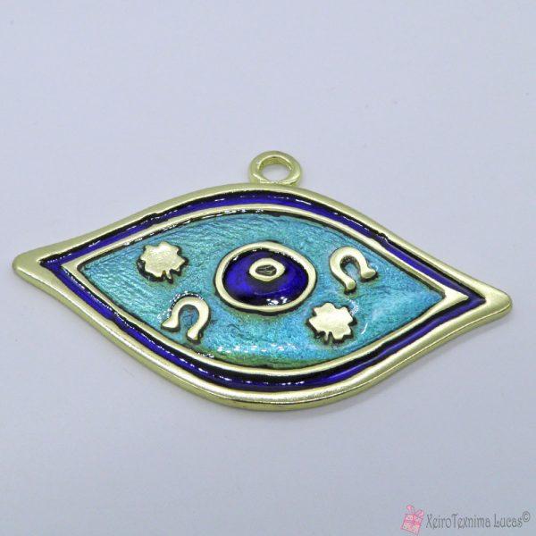 χρυσό μεταλλικό μάτι με μπλε σμάλτο