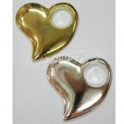Χρυσές και ασημί μεταλλικές καρδιές