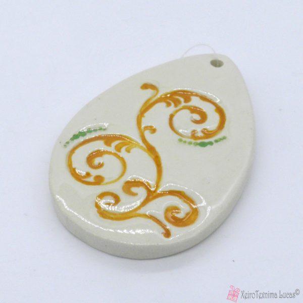 λευκό κεραμικό αυγό με κίτρινο σχέδιο δαντέλα