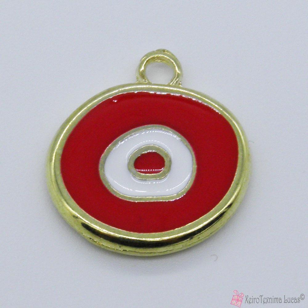 χρυσό μεταλλικό μάτι με κόκκινο σμάλτο