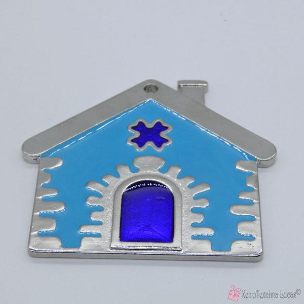 Ασημί μεταλλικό σπίτι με γαλάζιο σμάλτο