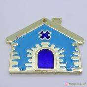 Χρυσό μεταλλικό σπίτι με γαλάζιο σμάλτο