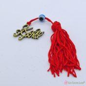 Μπρονζέ γούρι Καλή Χρονιά με κόκκινη φούντα