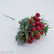 Χριστουγεννιάτικο κλαδί με κόκκινους καρπούς