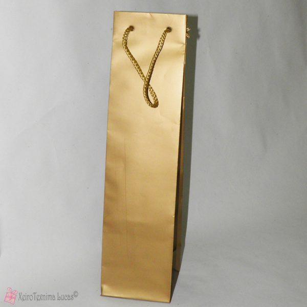 Χρυσή τσάντα για μια φιάλη