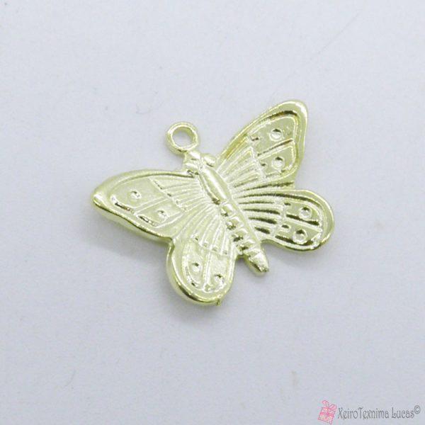 μεταλλικές πεταλούδες σε χρυσαφί χρώμα