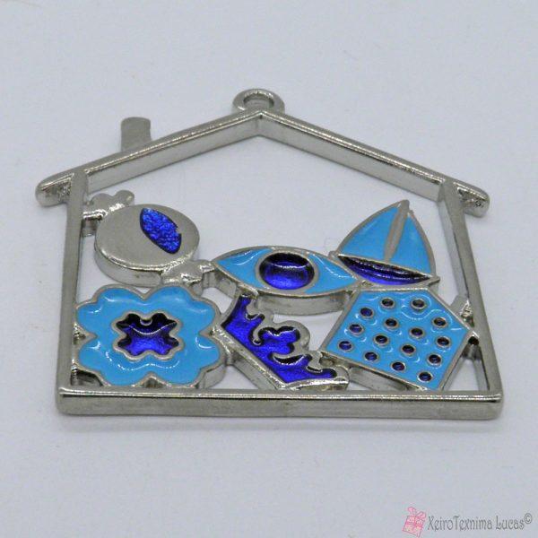 Ασημί μεταλλικό σπίτι με μπλε και γαλάζιο σμάλτο